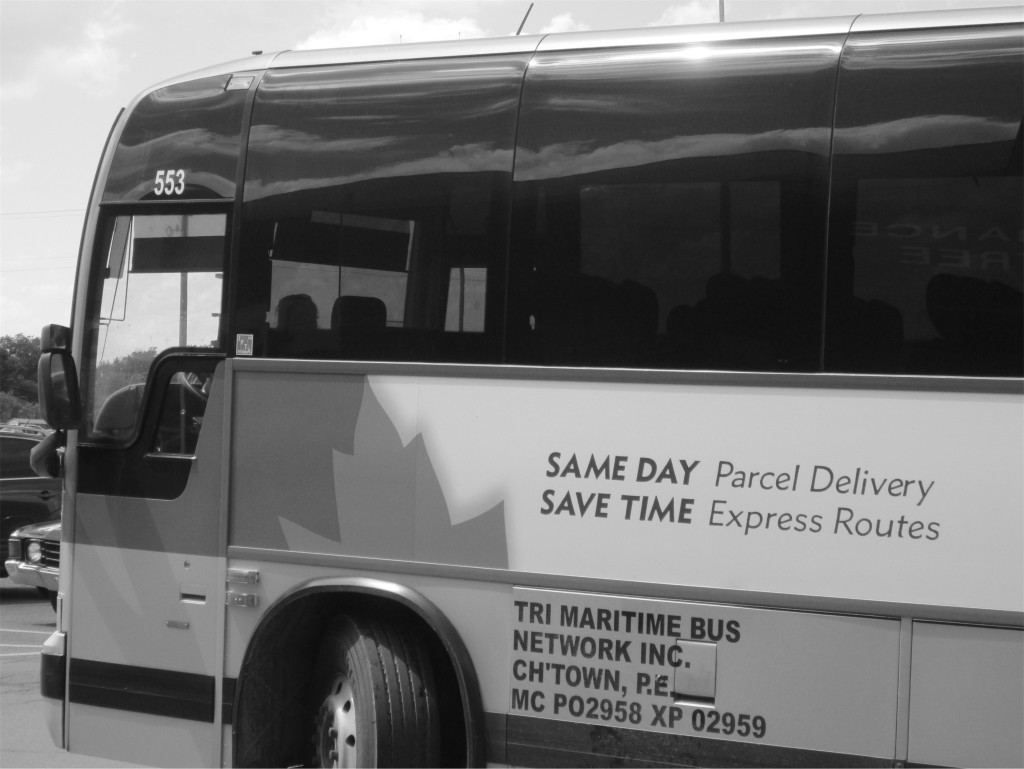 "Maritime Bus coach bearing the promise ""SAME DAY parcel delivery / SAVE TIME express routes"""