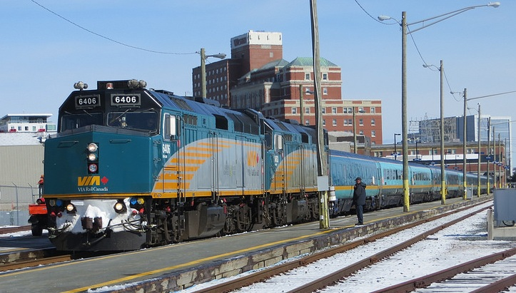 A VIA Rail train waits at a snow platform on a bright sunny day outside the train station in Halifax