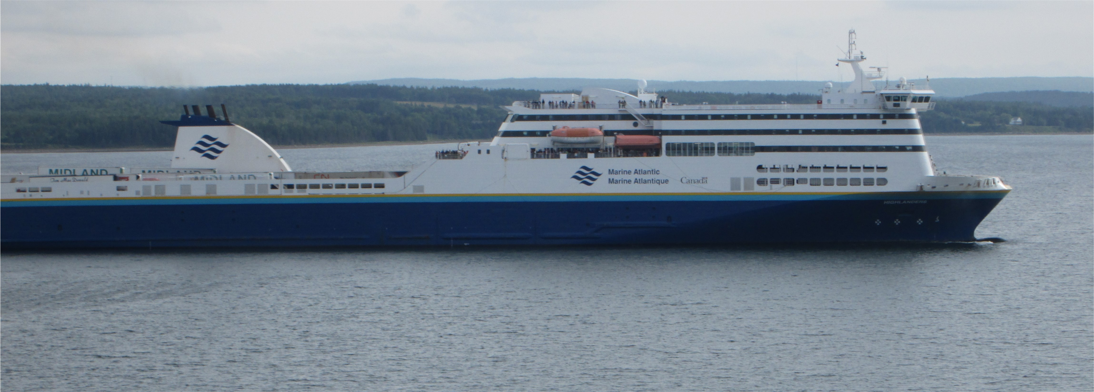 The Marine Atlantic Blue Puttees, a passenger and vehicle ferry, sails under an overcast sky