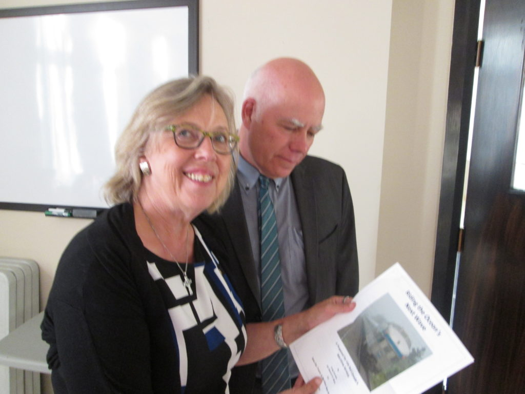 Federal Green Party leader and MP Elizabeth May and New Brunswick Green Party leader and MLA David Coon hold a copy of Greg Gormick's new report on the future of VIA's Ocean